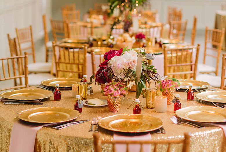 A formal set table with gold plates
