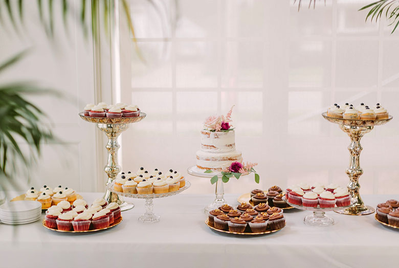 Colorful desserts on tall plates