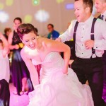 A bride and a groom dancing