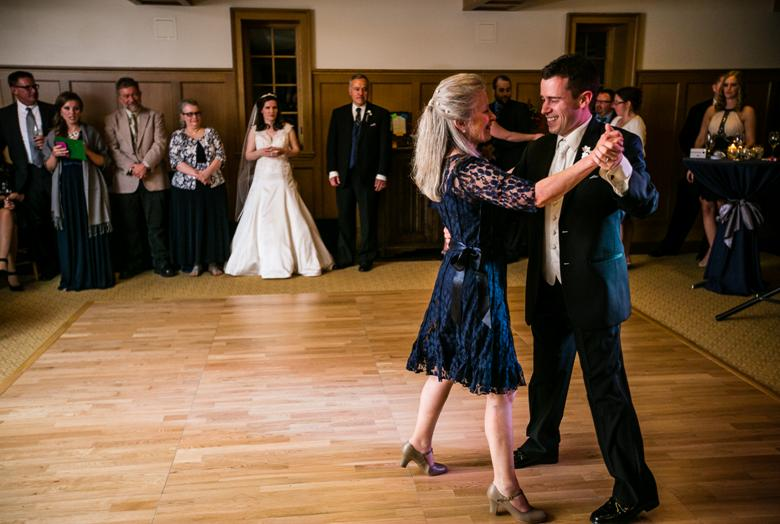 A groom and his mother dancing