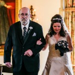 A bride walking arm in arm with her father