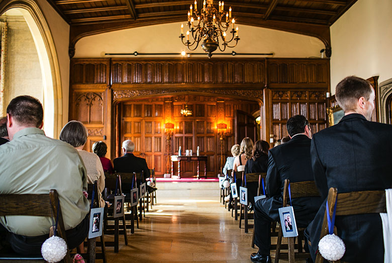 Guests seated inside an ornate hall for a wedding