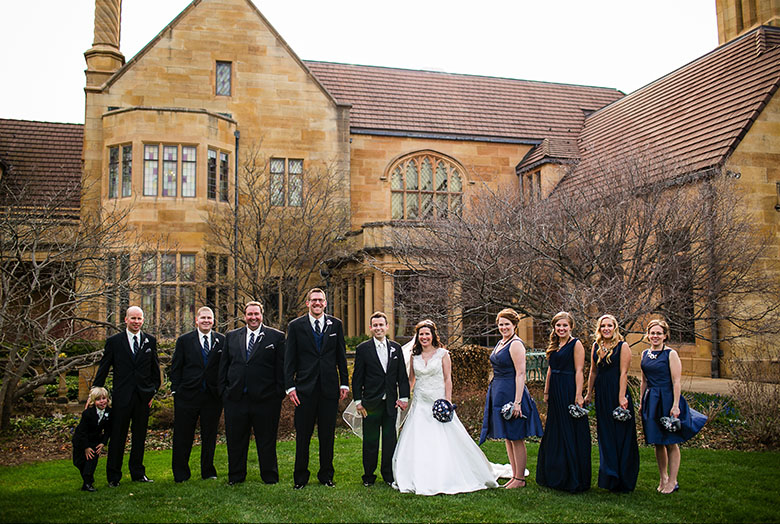 A wedding party outside the historic Paine mansion
