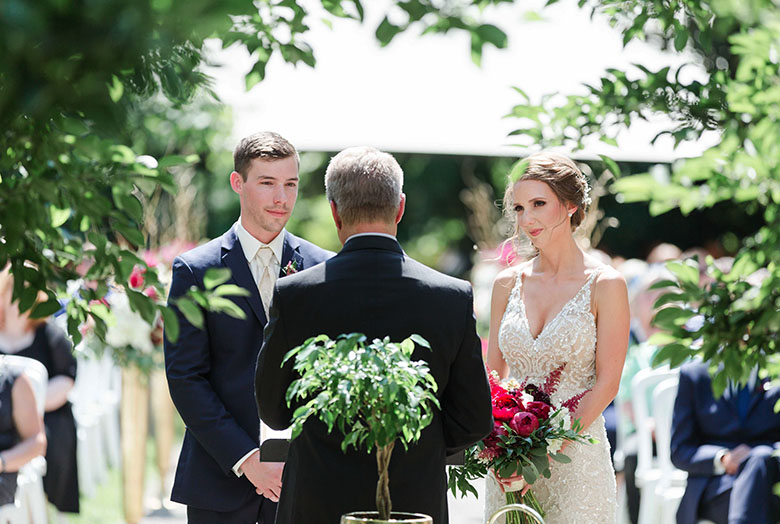 A bride and a groom saying their vows