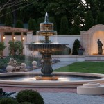 A fountain in a formal garden at dusk