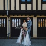 A bride and a groom in front of three doors