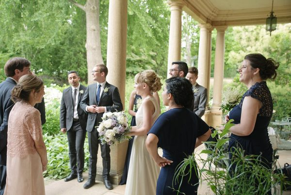 A bride and groom with a wedding party