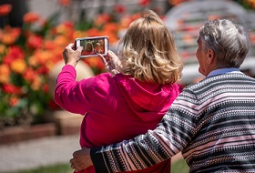 Two women taking a photo with a smartphone