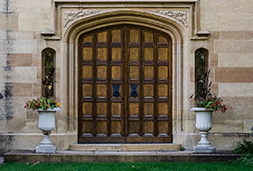 Old wooden doors of a mansion