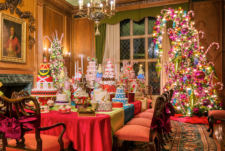 Dining room with Christmas tree and decorated cakes on table