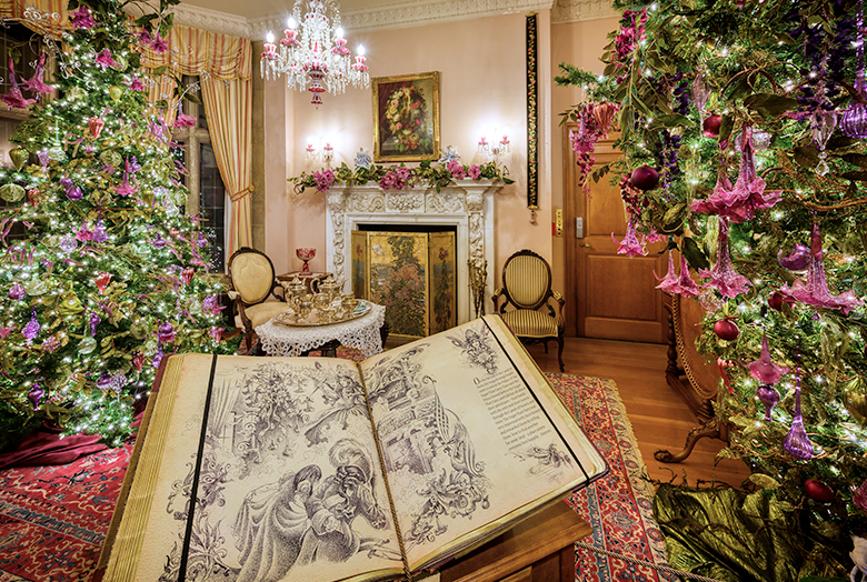 Room with pink Christmas decorations and a large storybook