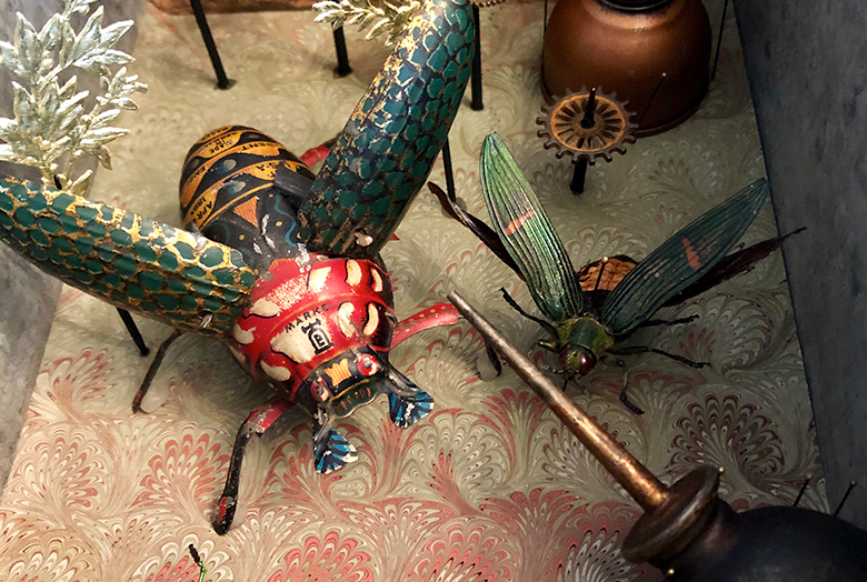 Artwork with antique insect toys
